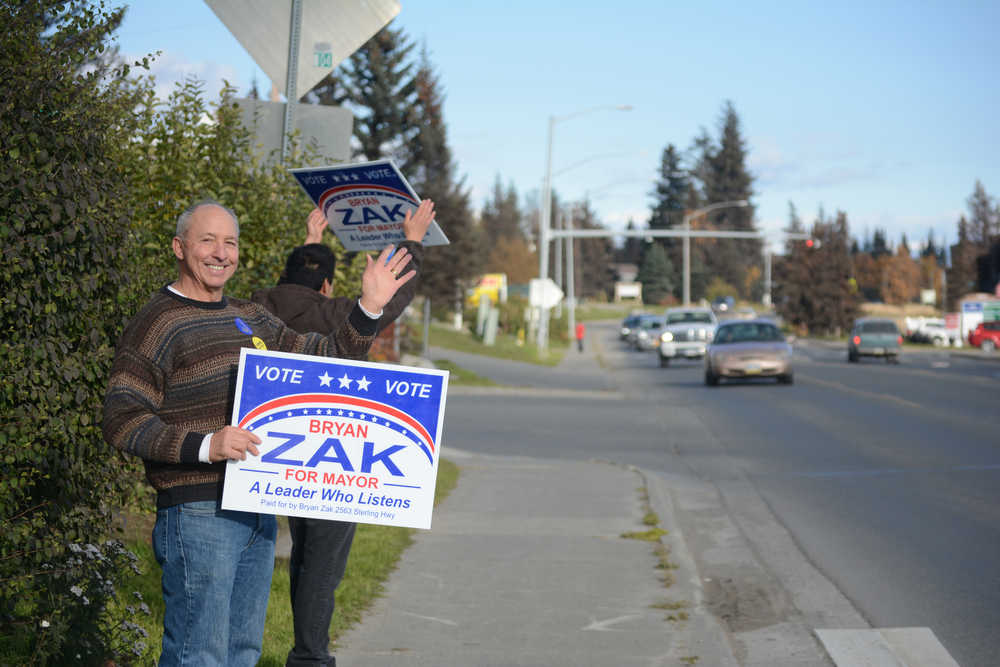 Homer City Council member Bryan Zak gets in some last-minute campaigning on Tuesday afternoon at WKFL Park on Pioneer Avenue. Zak appeared to have won election with unofficial results of 52 percent to David Lewis' 46 percent.