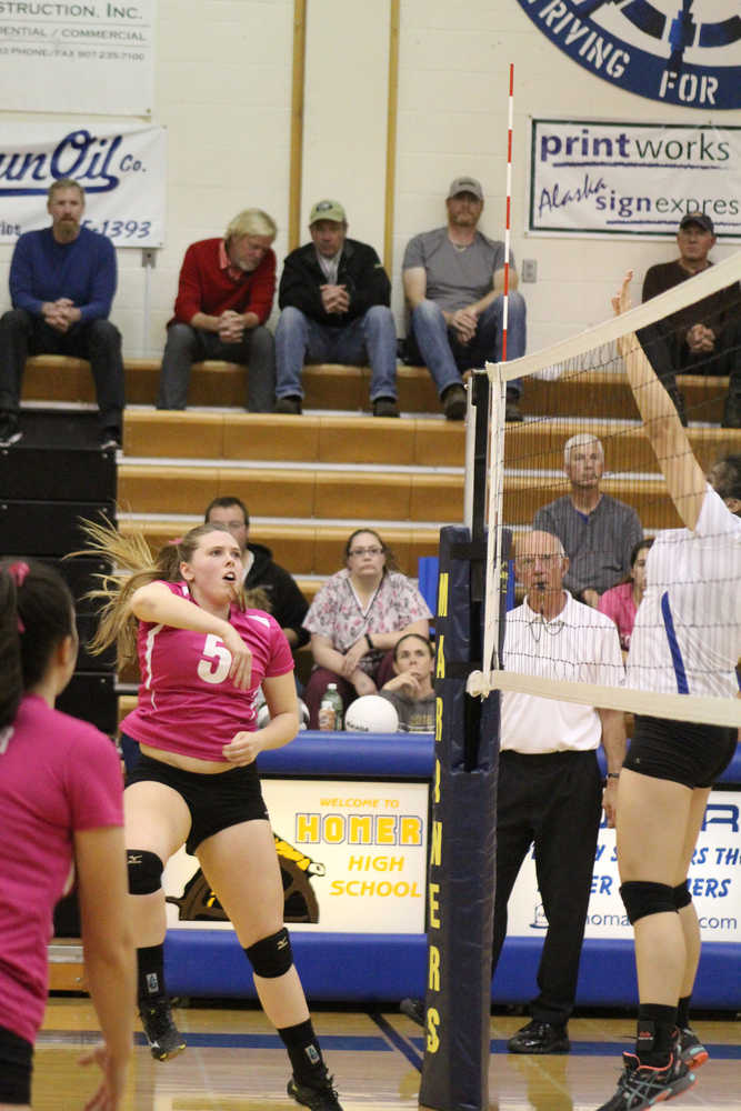 Mary Hana Bowe spikes the ball past a Cordova player during the Mariner home game on Thursday, Oct. 6.