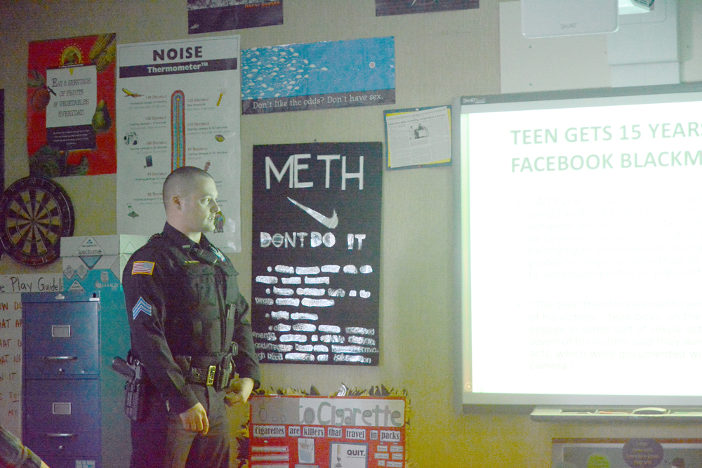 Homer Police Sgt. Ryan Browning talks about digital consciousness last month for Chris Perk's 9th grade health and physical education class at Homer High School.