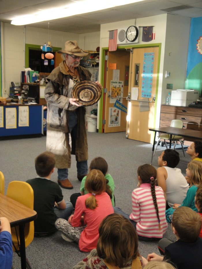 Reality TV Star and Kachemak Bay homesteader Atz Kilcher talks to students  at Paul Banks Elementary School during the 100-day school surprise.-Photo provided