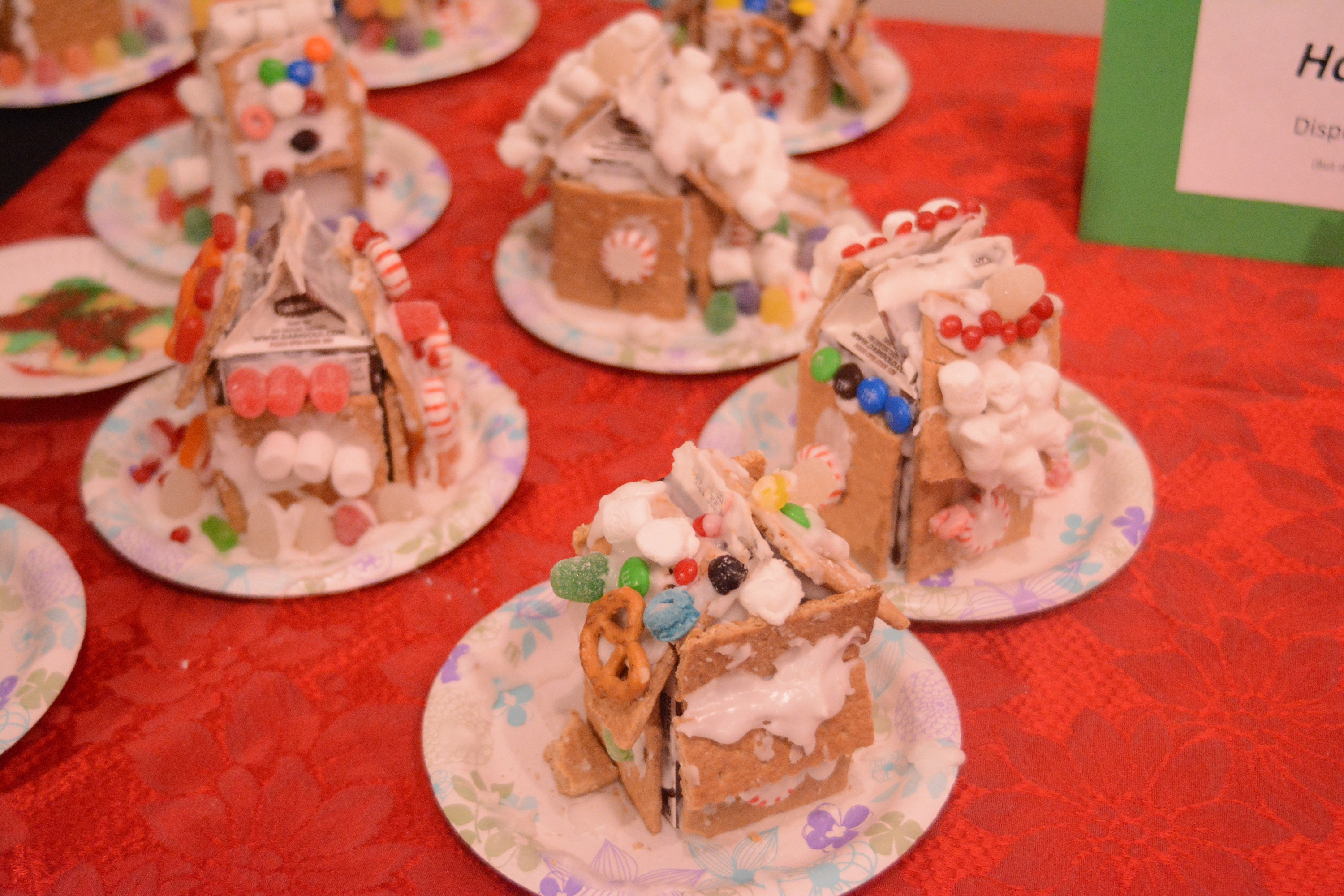 Completed graham-cracker houses are on display. The  Pratt Museum's annual event also included a visit from Santa Claus in the museum's historic Harrington Cabin.-Photo by Michael Armstrong, Homer News