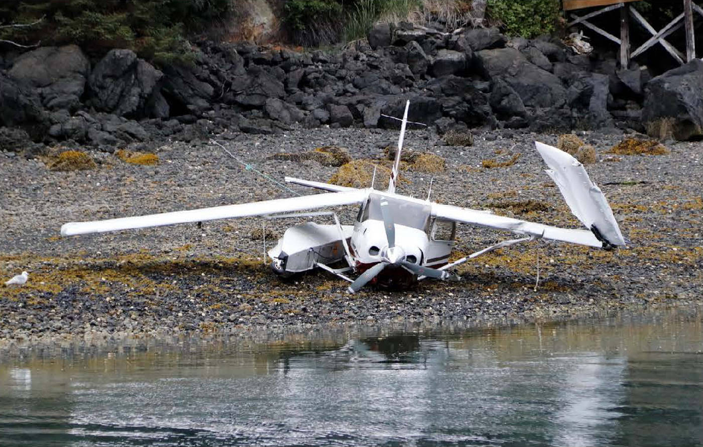 This photo from a National Transportation Safety Board report shows Alaska Dispatch News owner Alice Rogoff's Cessna 206 on the beach, sans floats, after a crash landing into the water on July 3, 2016 in Halibut Cove, Alaska. The NTSB noted in its report that Rogoff's attempted landing happened over glassy water conditions. (Photo courtesy NTSB)