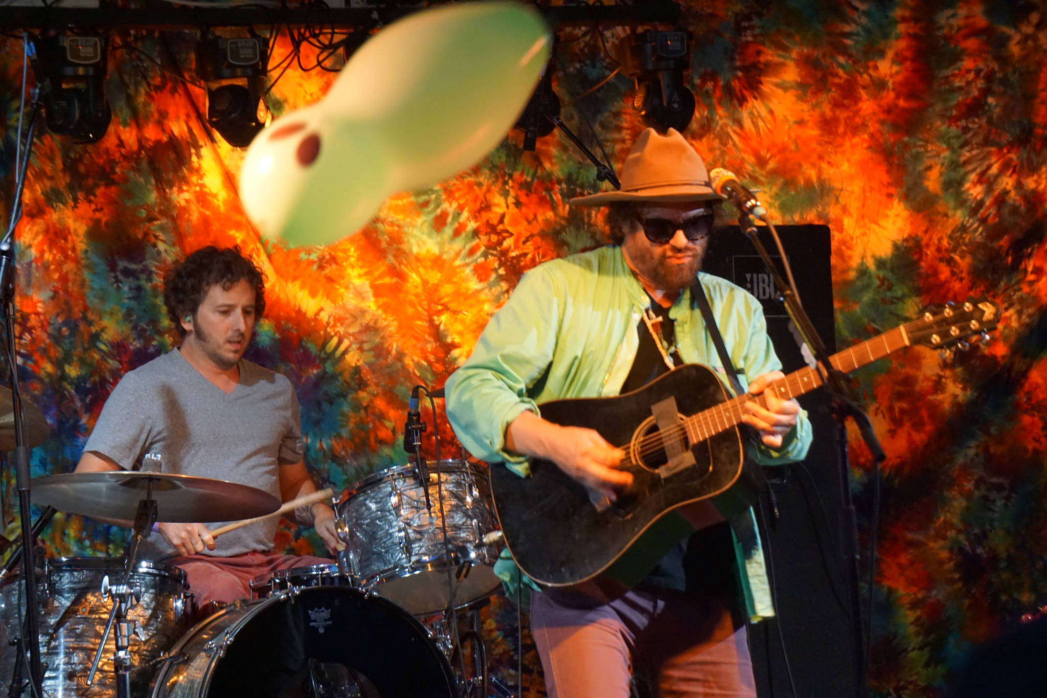 Zil Fessler, left, and Michael Glabicki of Rusted Root perform on Saturday night, Aug. 5, 2017, at Salmonfest, Ninilchik, Alaska. A balloon bounces over the crowd. (Photo by Michael Armstrong, Homer News)