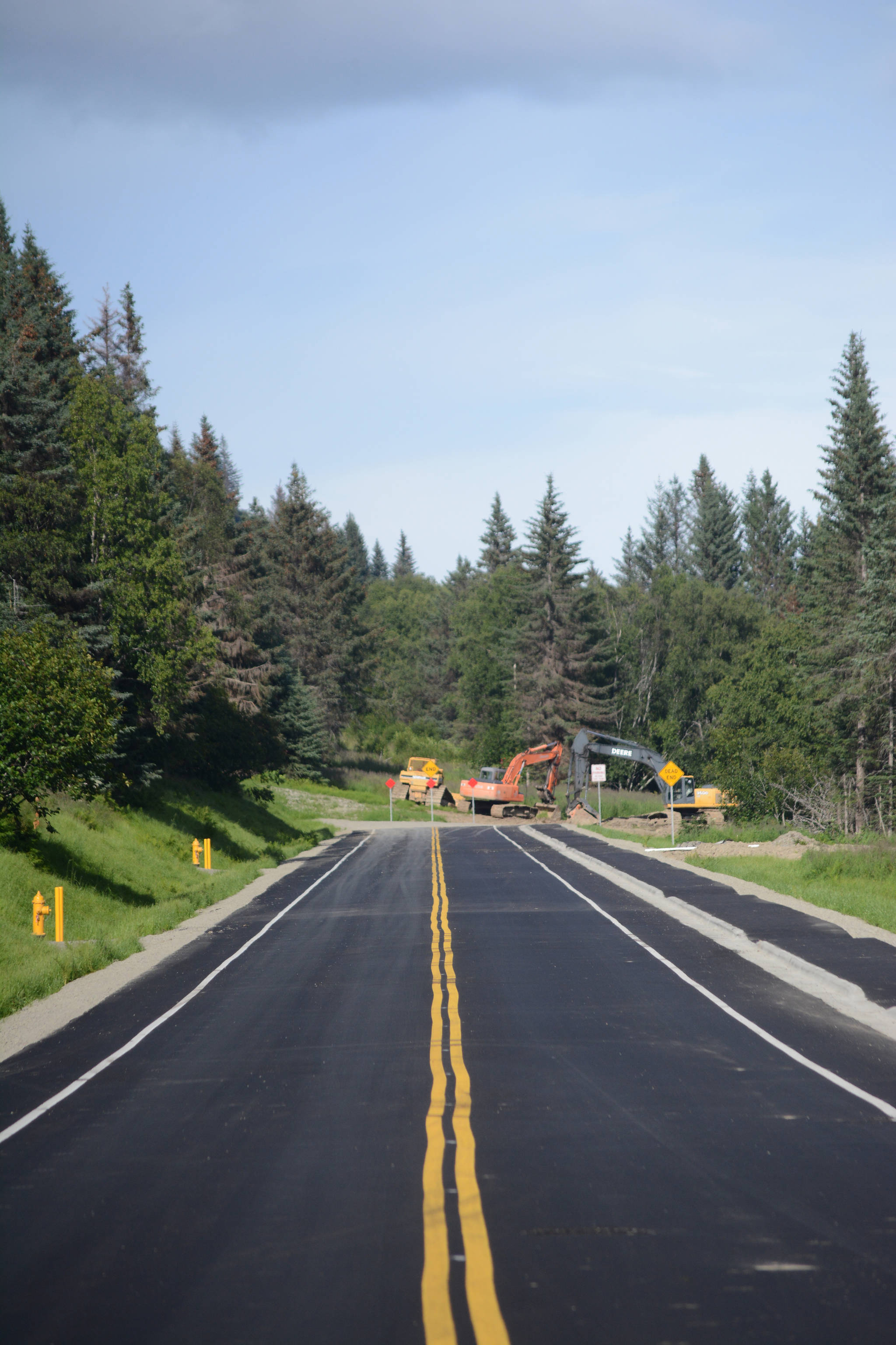 Paving, curbs and sidewalks are complete on Homer's newest street, Eric Lane off West Hill Road. (Michael Armstrong/Homer News)