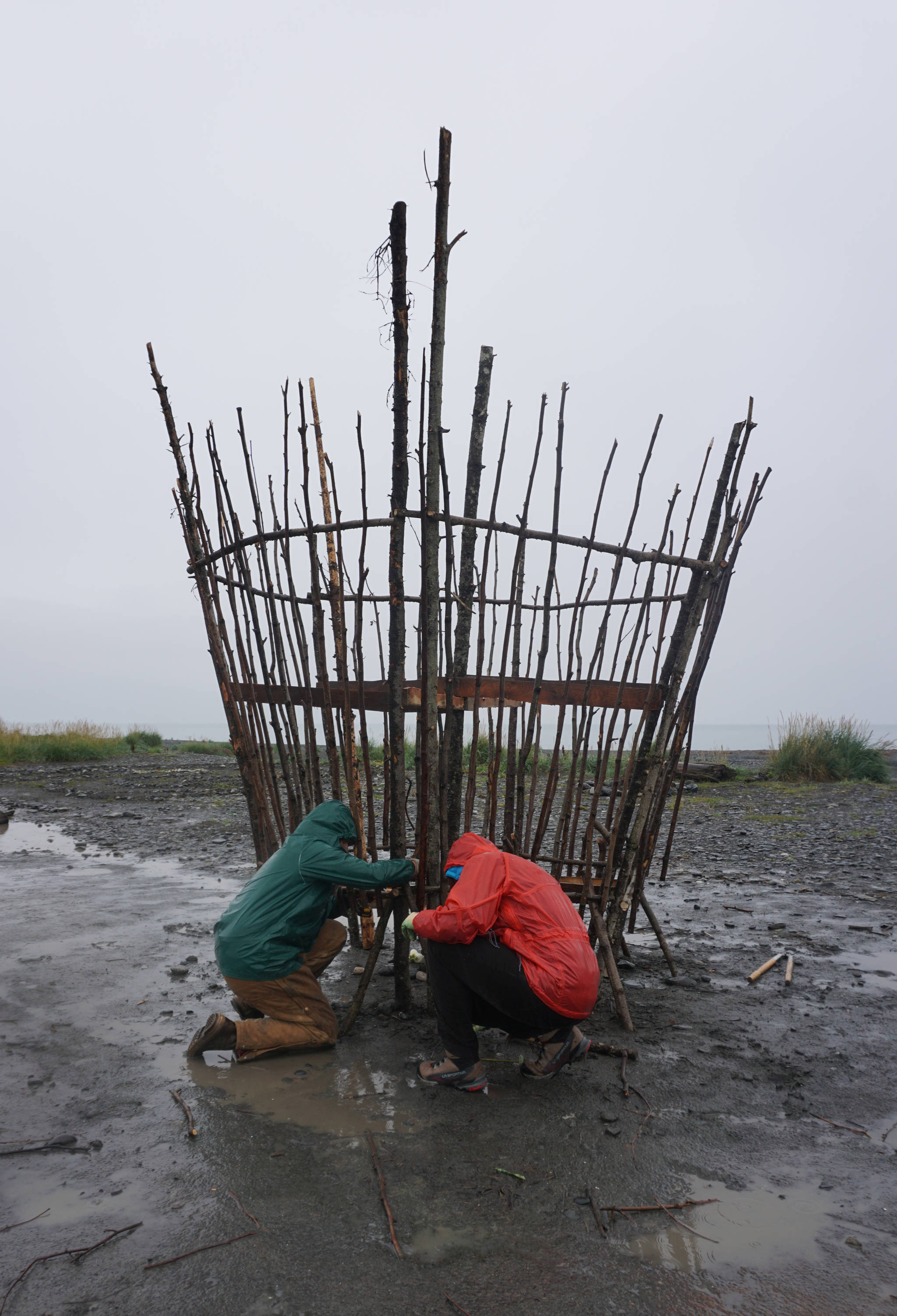Robin Austin, left, and Natalia Mulawa, right, work on Shine, this year's Burning Basket, Tuesday, Sept. 5, 2017 at Mariner Park on the Homer Spit, Alaska. The annual interactive art project will be offered to the community on Sunday and then transformed into heat and light at sunset. (Photo by Michael Armstrong, Homer News)