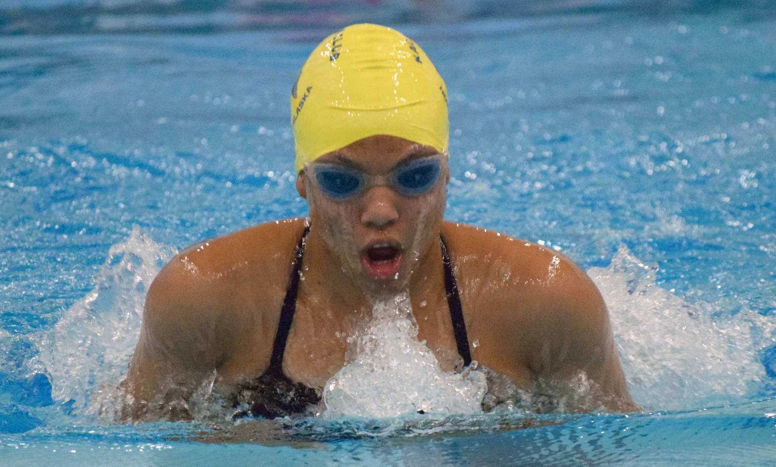 Homer's Alia Bales competes in the 50-yard breaststroke Friday, Sept. 22, 2017, at the Soldotna Pentathlon at Soldotna High School. (Photo by Jeff Helminiak/Peninsula Clarion)