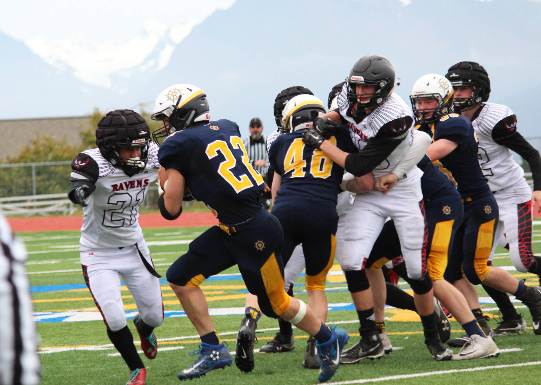 Homer sophomore Noah Fisk runs the ball during Homer's football game against Ben Eielson High School on Saturday, Oct. 7, 2017 in Homer, Alaska. The Mariners beat the Ravens 33-21 and will head to the ASAA First National Bowl Series Division III Championship. (Photo by Megan Pacer/Homer News)