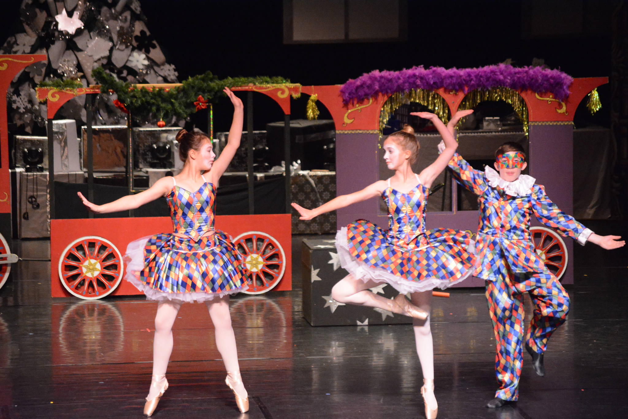 Serena Funkhauser, Ava Halstead and Lance Seneff as the harlequin toys rhearse a scene at the Mariner Theatre Friday, Nov. 24, 2017 in Homer, Alaska for the Nutcracker Ballet. (Photo by Michael Armstrong, Homer News)