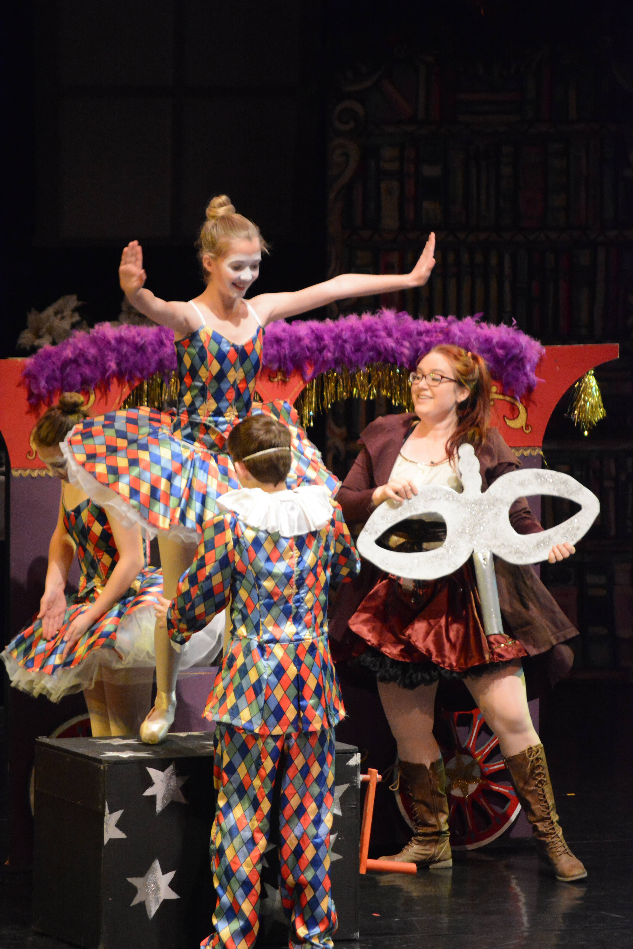 Hannah Heimbuch as Aunt Drosselmeyer, far right, rehearses a scene with Serena Funkhauser, left, Ava Halstead, center, and Lance Seneff, right, as the harlequin toys at the Mariner Theatre Friday, Nov. 24, 2017 in Homer, Alaska for the Nutcracker Ballet. (Photo by Michael Armstrong, Homer News)