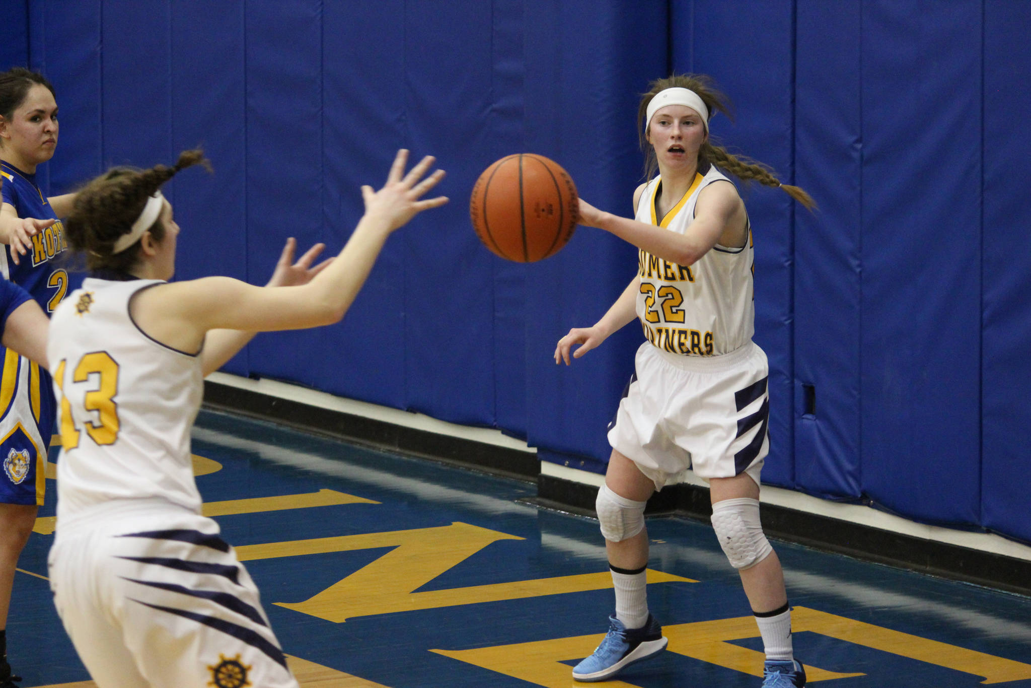 Homer's Alissa Cole passes the ball to Rylyn Todd durng the girls team's first game in the Homer Winter Carnival Tournament on Thursday, Feb. 8, 2018 at the Alice Witte Gymnasium in Homer, Alaska. (Photo by Megan Pacer/Homer News)