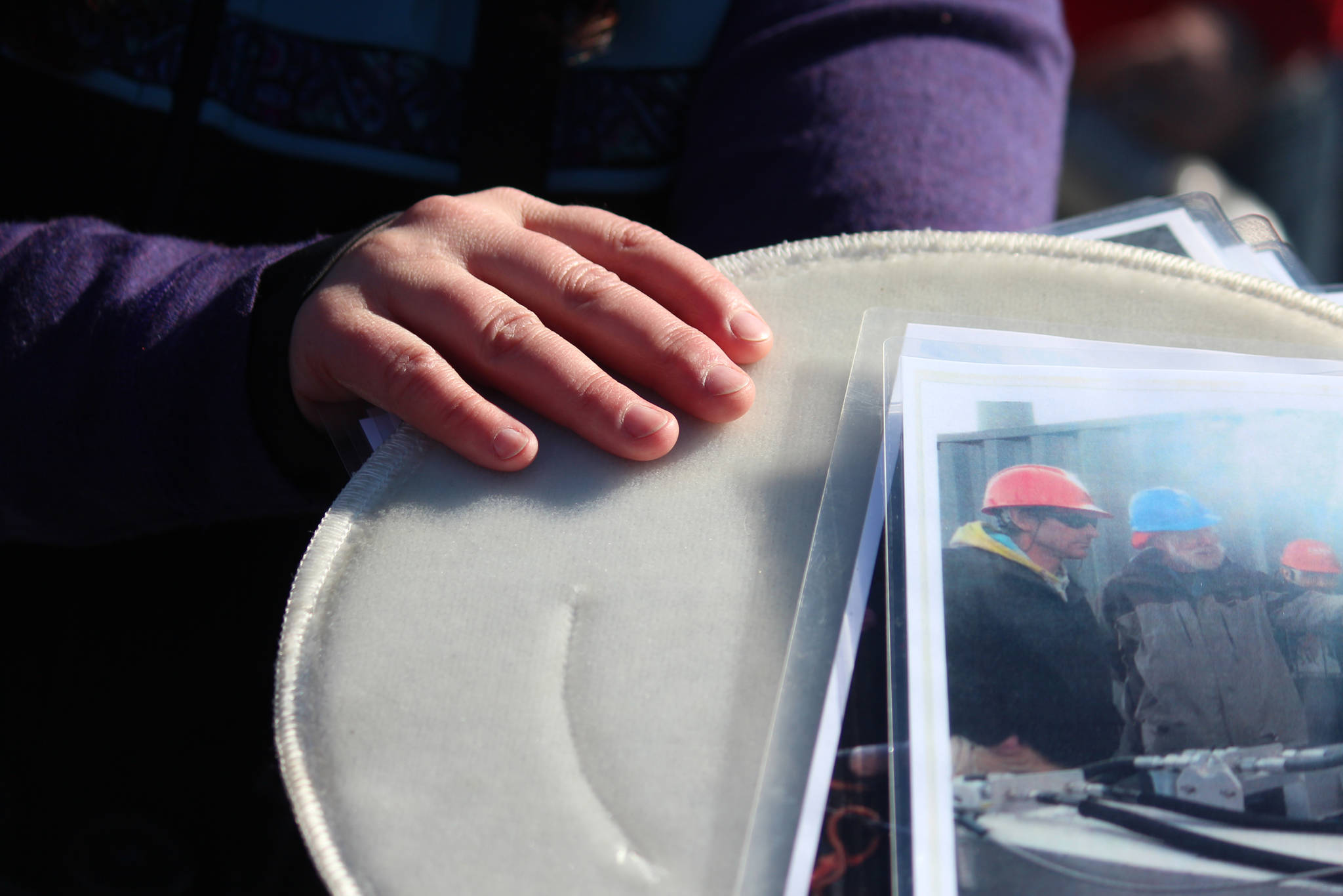RCAC Outreach Coordinator Lisa Matlock shows Homer area residents aboard the Discovery an example of the filters used to catch oil during a spill while on a tour of annual oil spill response training in Kachemak Bay on Saturday, April 14, 2018 in Homer, Alaska. The public tour was a first for Homer and was hosted by the Prince William Sound Regional Citizens' Advisory Council in conjunction with Alyeska Pipeline, Alaska Coastal Marine and the Center for Alaskan Coastal Studies. (Photo by Megan Pacer/Homer News)
