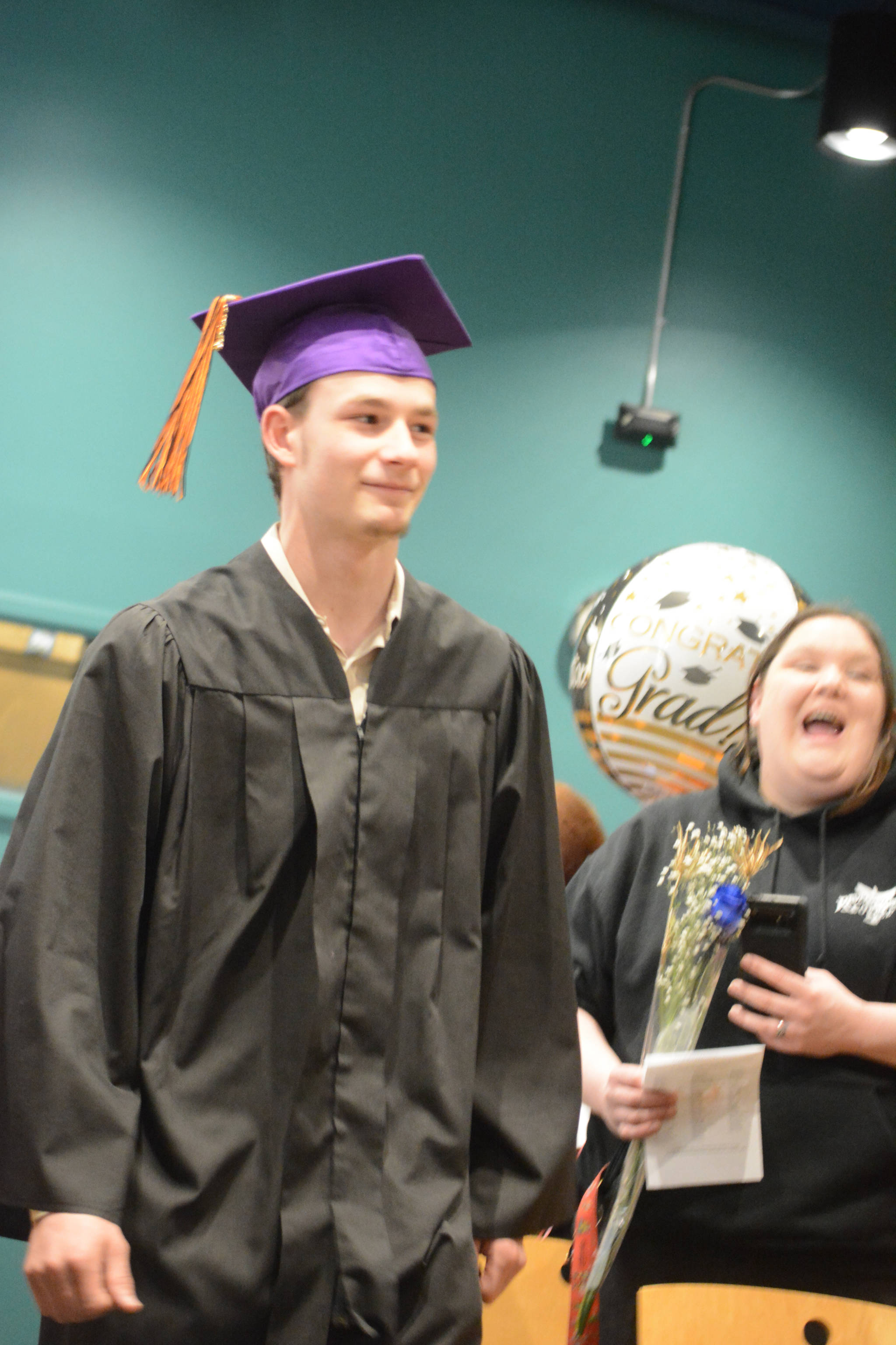 Flex High School graduate Matthew Prescott walks during the processional. Nine students graduated from Flex on Tuesday night, May 22, 2018, at the Alaska Islands and Ocean Visitor Center auditorium, Homer, Alaska. (Photo by Michael Armstrong / Homer News)