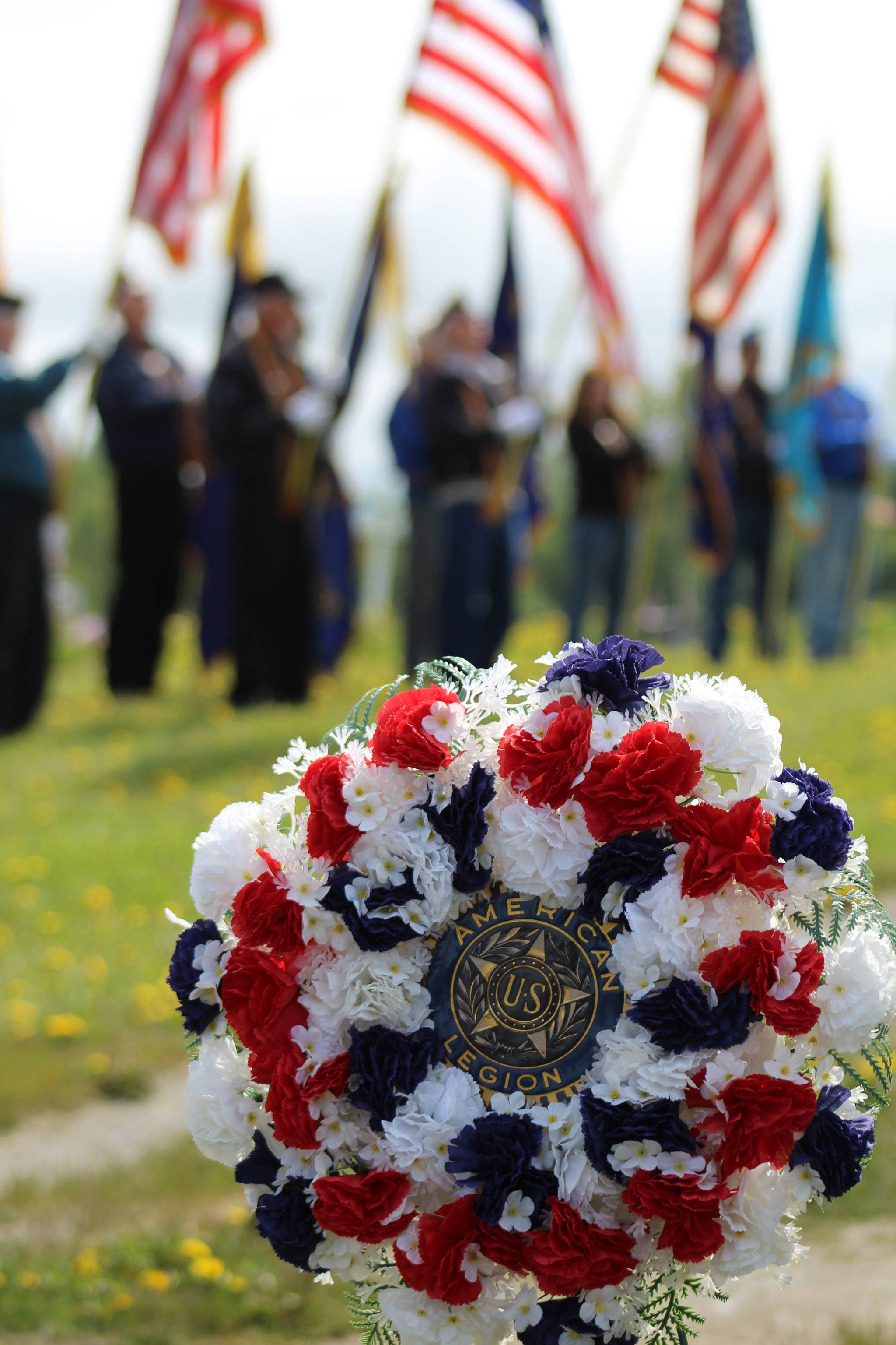 An American Legion flower wreath decorated the Ninilchik Cemetery at a 2106 Memorial Day service to honor those fallen in battle. (Homer News file photo)