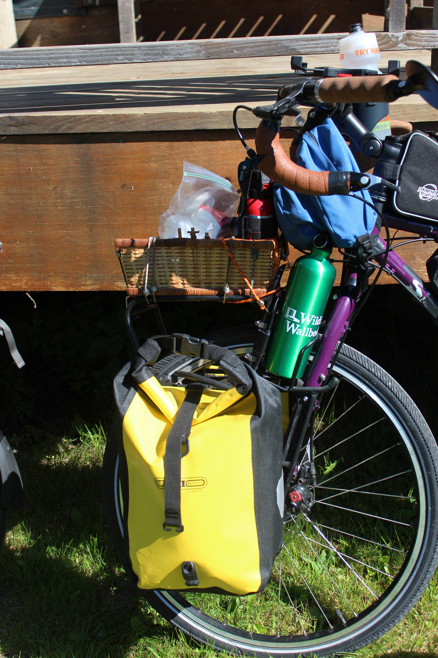 Gear rests affixed to Chris Haag's bike in various locations as he and his wife, Sophie George, prepare to start on a journey from Alaska to Argentina on Monday, July 2, 2018 in Homer, Alaska. Each will carry about 80-100 pounds of supplies, food and water on their bikes for the two-year adventure. (Photo by Megan Pacer/Homer News)