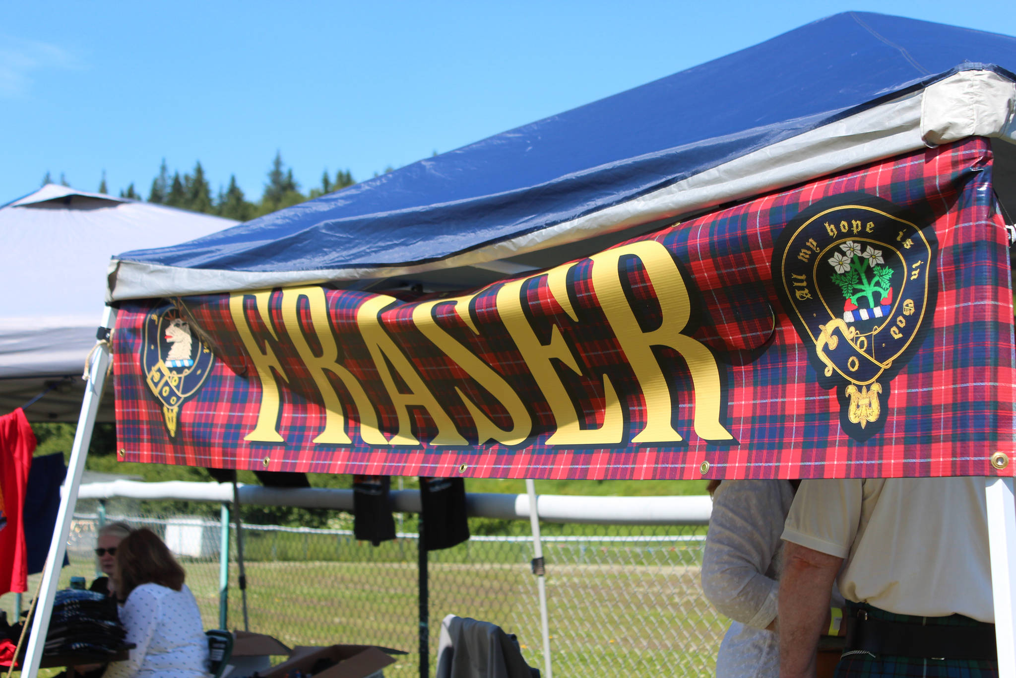 A clan booth advertises the Fraser clan at this year's Kachemak Bay Scottish Highland Games on Saturday, July 7, 2018 at Karen Hornaday Park in Homer, Alaska. (Photo by Megan Pacer/Homer News)