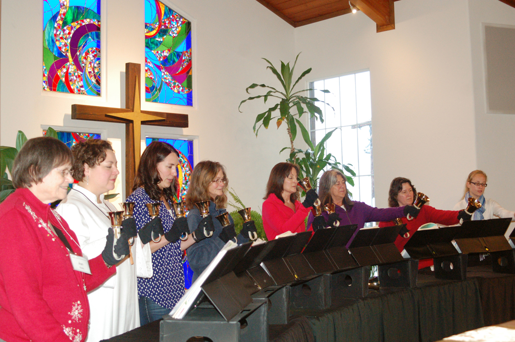 The Jubilation! Bells choir practices after services on Sunday at Homer United Methodist Church. From left to right are Joan Evans, Pastor Lisa Talbott, Katie Bynagle, Susan Clardy, Mary Fell, Lucy Kunkler, Karen Sonnen and Jessica Sonnen. The Jubilation! Bells choir will perform tonight, Dec. 24, beginning at 6:30 p.m. at the Homer United Methodist Church. The Christmas Eve service officially begins at 7 p.m.