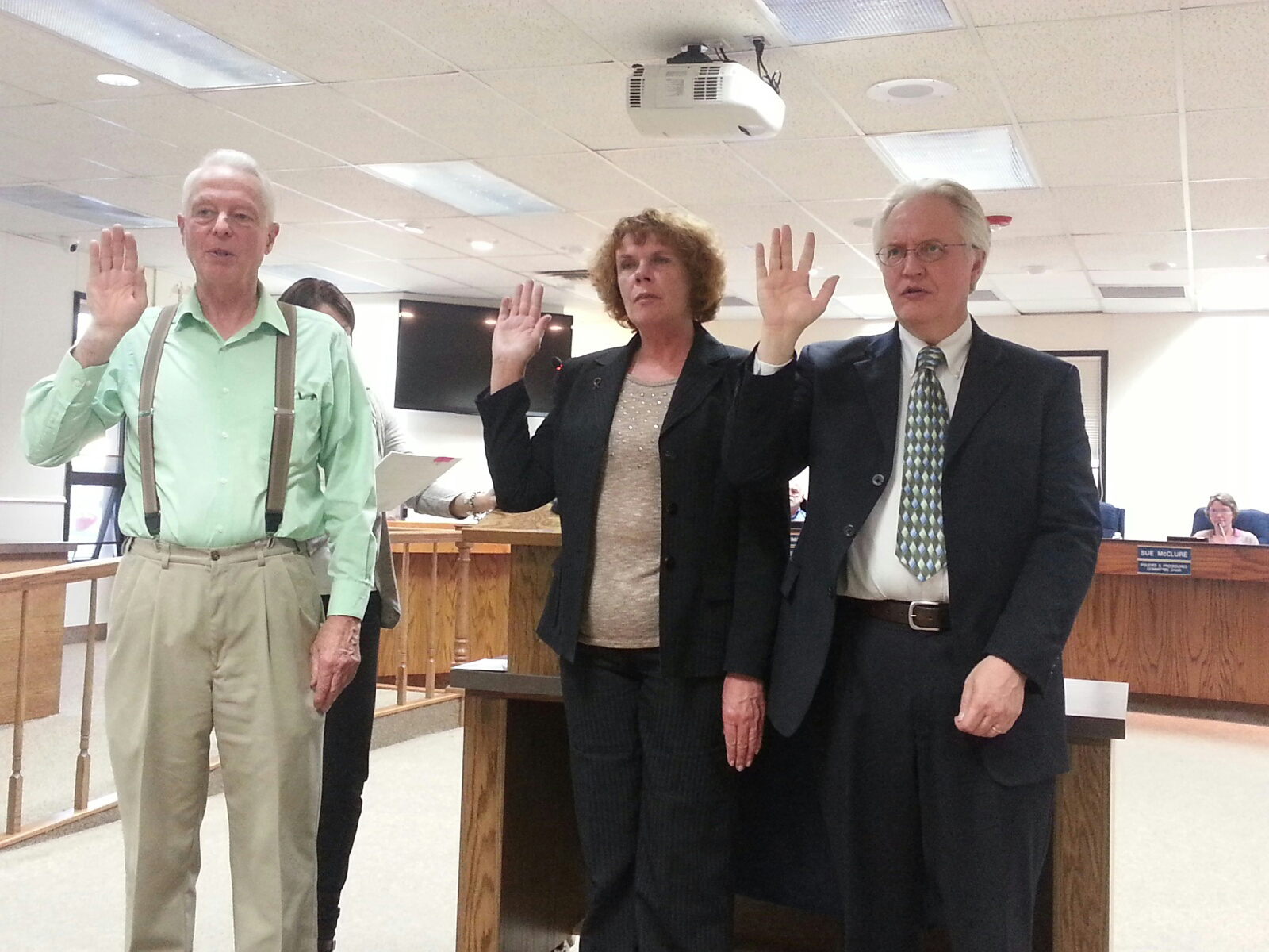 The three newly elected Kenai Peninsula Borough Assembly members are sworn in to office at Tuesday's assembly meeting in Soldotna. From left are Stan Welles, who will replace Charlie Pierce in the Sterling and Funny River district; Kelly Cooper, who will replace Bill Smith for the Homer district seat; and Blaine Gilman, who will replace outgoing Kenai district member Hal Smalley.-Photo by Dan Balmer, Morris News Service - Alaska