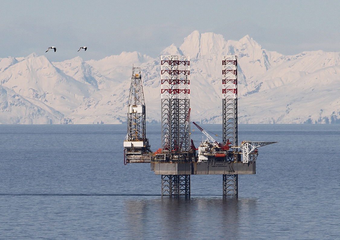 The Endeavour-Spirit of Independence jack up rig, seen here in early April at the Cosmopolitan site near Anchor Point, has spudded its first well nine months after it arrived in Cook Inlet from Singapore in mid-August 2012. Buccaneer said it would drill to a depth of 8,000 feet to test for oil and gas on the site. Drilling is expected to take 45 days.-Photo by Brian Smith/Peninsula Clarion