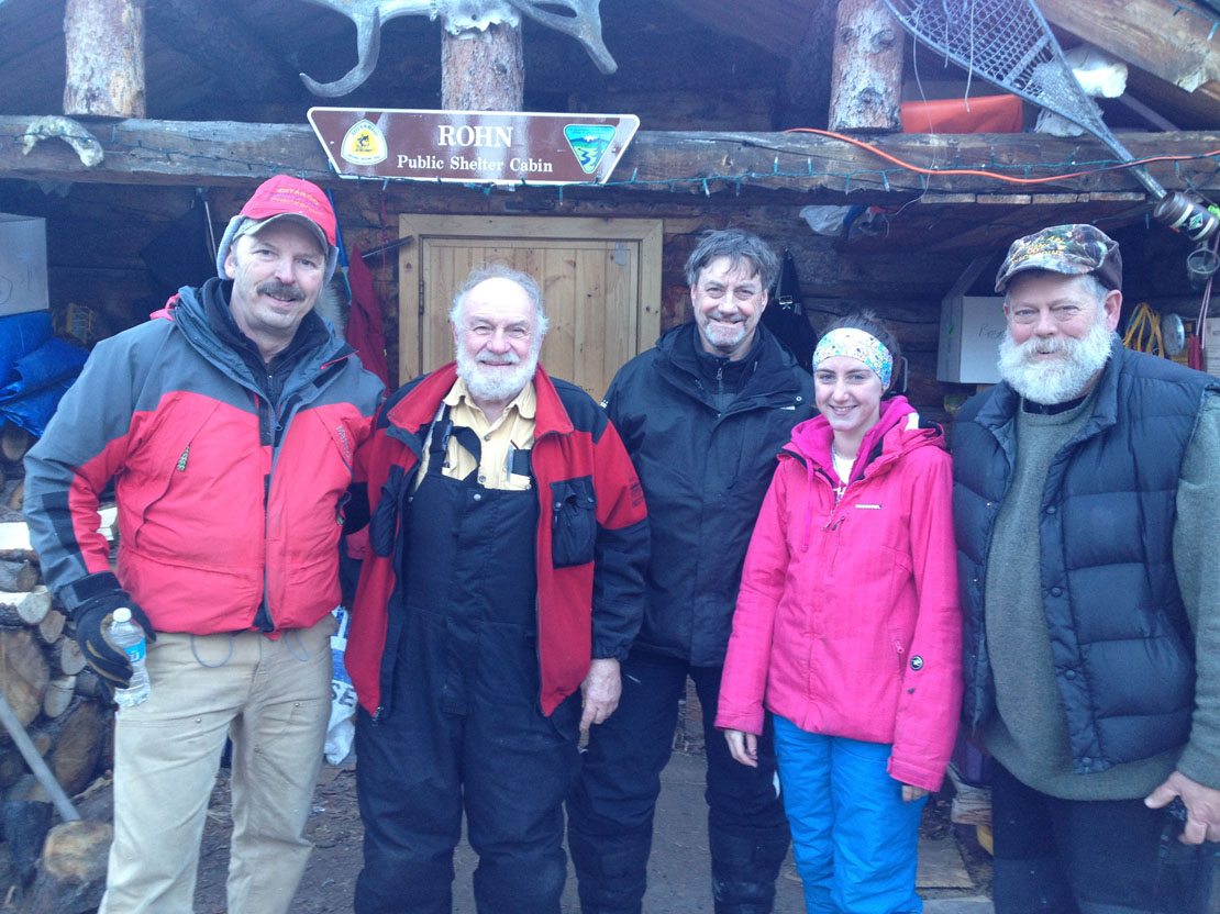 """Terry Boyle, known as the """"sheriff of Rohn,"""" Dr. Paul Sayer, Dr. Paul Raymond and his daughter Kendra, and Jasper Bond, known as the """"mayor of Rohn,"""" pose for a photo. Boyle and Bond are Iditarod checkers at the Rohn checkpoint, 712 miles from Nome.-Photo provided"""