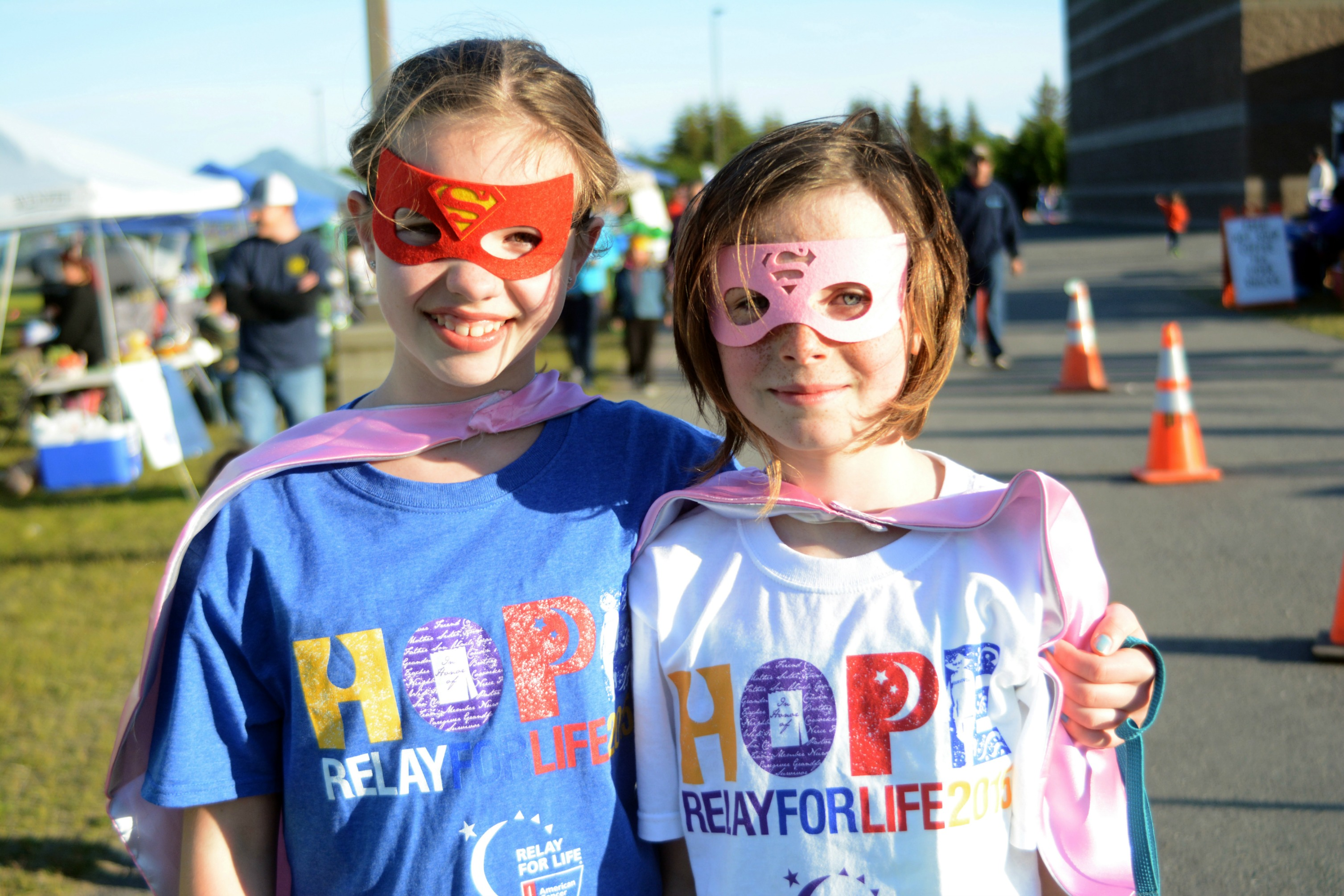 Sophia Park, left, and Neviya Reed of Team Puppies pause for a photo during the 2015 Relay for Life.
