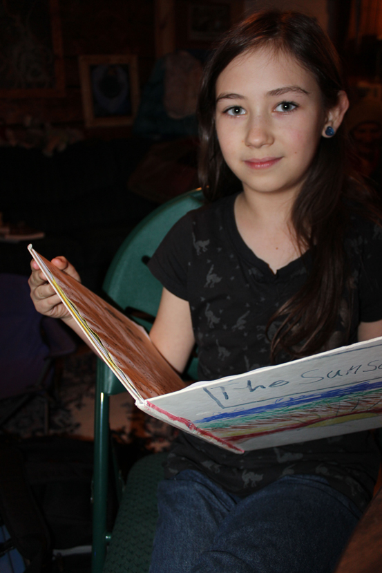 """Connections student Zion Jackinsky reads from """"The Sunset,"""" an unpublished book she wrote and illustrated."""