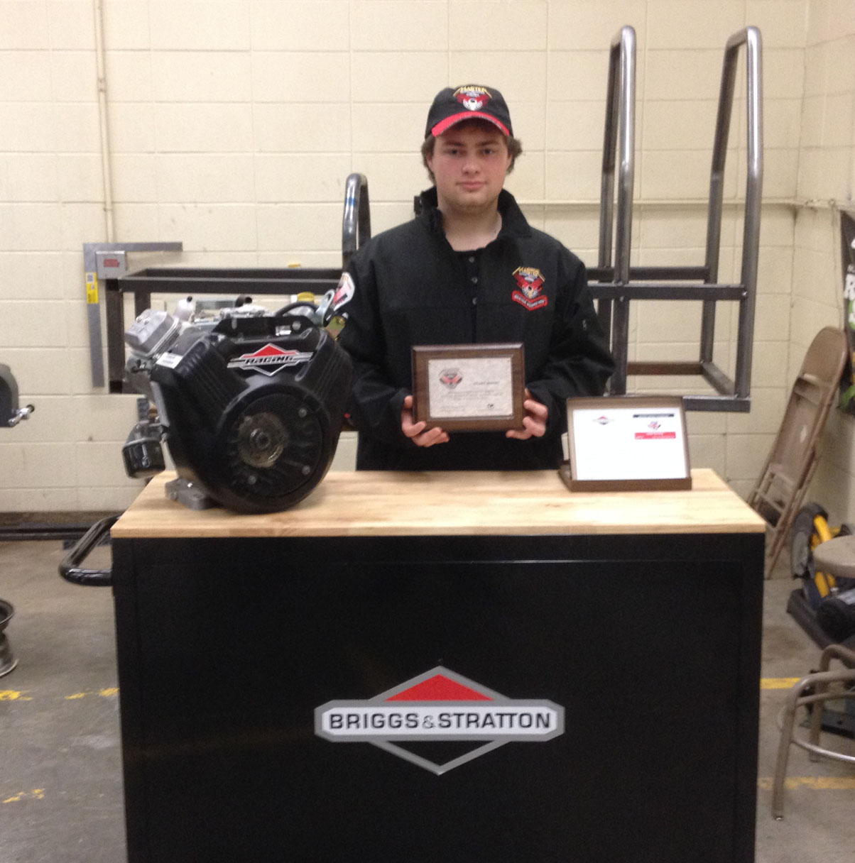 Receiving a certificate for having achieved the Briggs and Stratton MST, master service technician, rating, Homer High School junior Nolan Bunting also was gifted by the company with other items. Bunting is enrolled in Homer High's small engine class taught by Cam Wyatt.-Photo provided