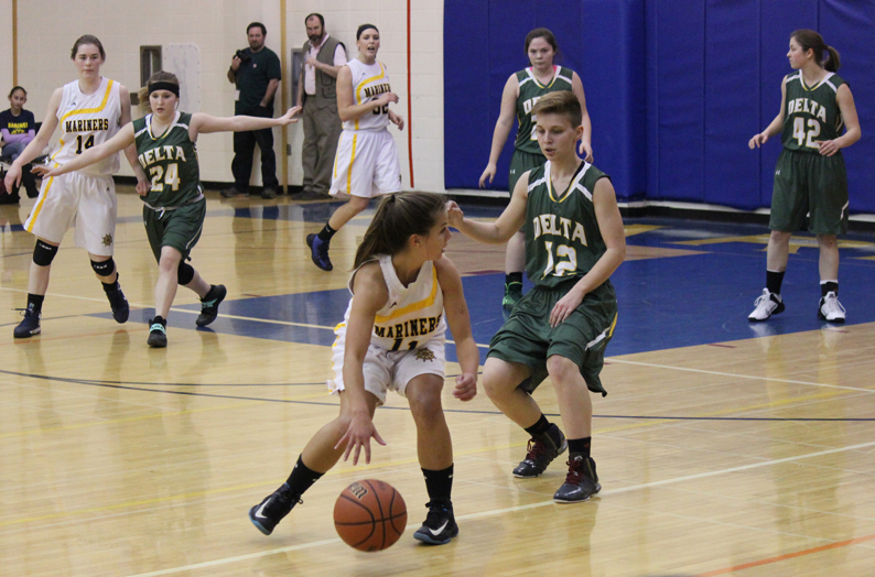 Mariner Maggie Koplin, No. 11, controls the ball during the game with Delta Junction while teammates Madison Akers, No. 14, and Tayla Cabana, No. 32, watch her back.-Photo by McKibben Jackinsky, Homer News