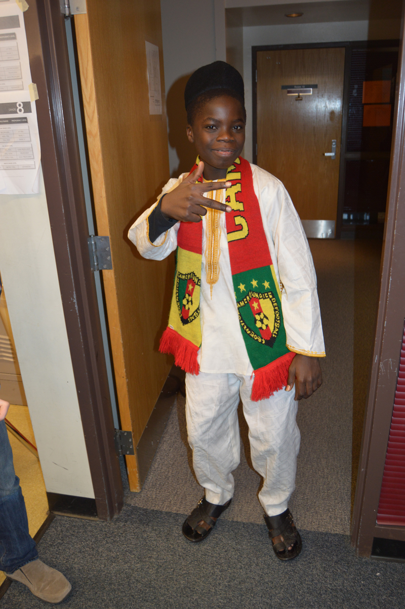 Cameroonian exchange student Nouredine Mama poses in traditional dress during a presentation about his country for students at Nikolaevsk School on Nov. 25.-photo by Annie Rosenthal