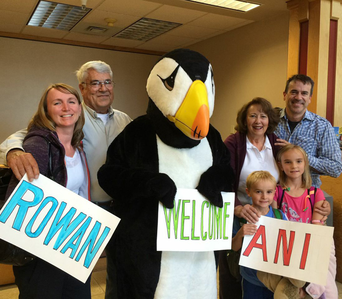 The LeFevre family pose with the Homer Senior Citizens puffin at the Homer airport in July. From left are Karyn, Russ, the puffin (Kyle Edens), Jane, Rowan, Ani and Russell LeFevre.-Photo provided