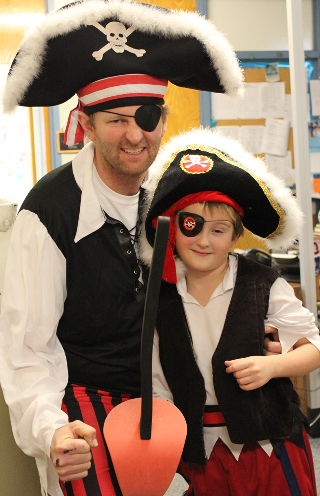 Paul Banks Elementary School Principal takes on the persona of Redbeard the Pirate, with a younger version played by his son, Einar, during the school's readathon kick-off assembly on Monday.