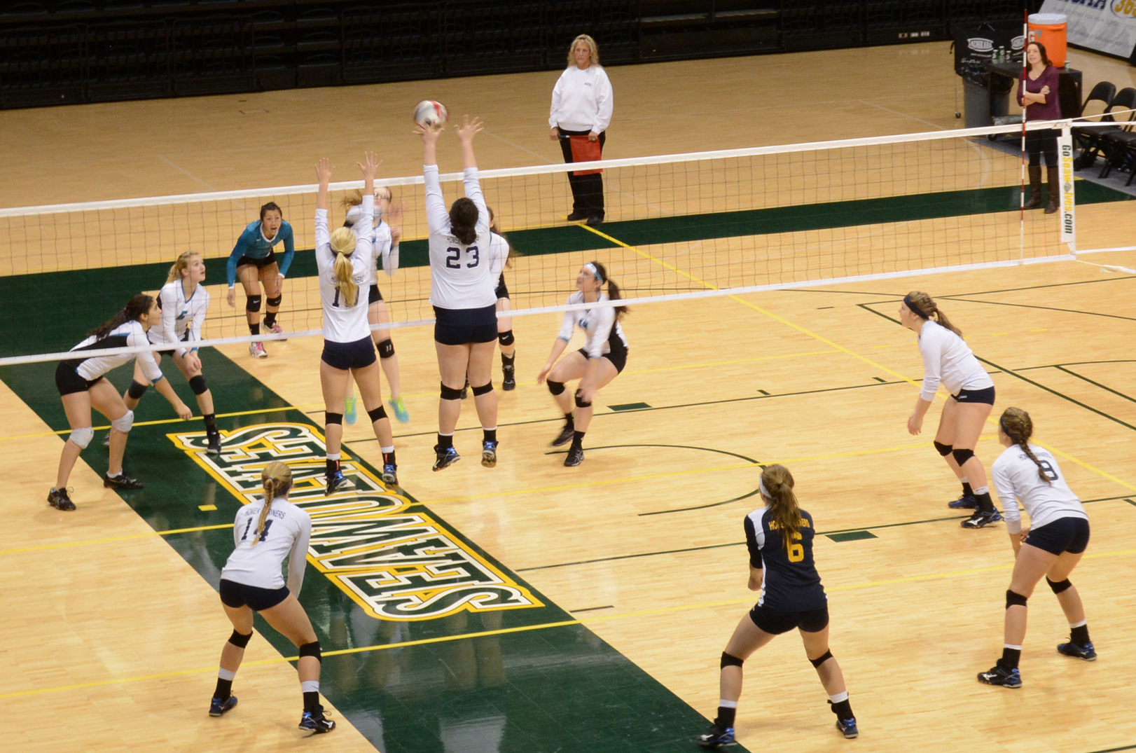The Mariners hold a tough defense as Kyla Pitzman (23) and Jane Rohr (10) jump to block Nikiski in Match 9 of the tournament at the Alaska Airlines Center. Pitzman and Rohr were both named to the 2014 State All-Tournament team.-Photo by Stephanie Pitzman