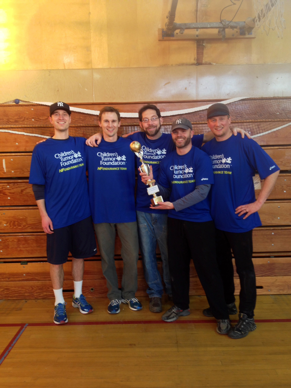 Team Jobu's Mark Putney, Dan Olson, Michael Mahmood, Campbell and Brandon Young accept the championship trophy. Also participating were the Master Blasters, Team Lowe and the High Lifers. -Photo provided