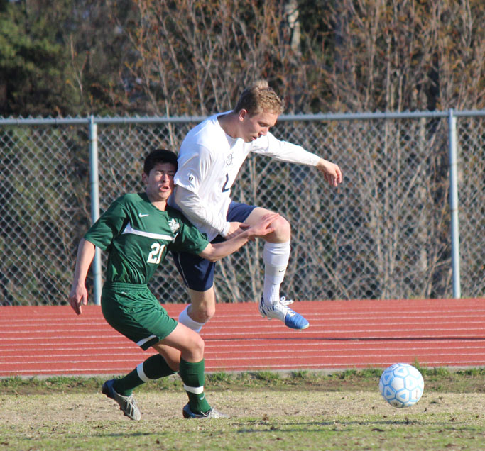Mariner Drew Brown gets the jump — literally — on a member of the Colony Knights soccer team as the two scramble for control of the ball during Friday's game.