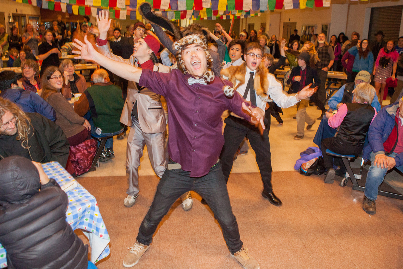 Ben Westphal, a senior at Homer High School, surprises the crowd at the Homer Outdoor Film Festival by leading the HoWL Skits 'n Scats crew in a flashmob dance number amid the audience. Westphal choreographed two dance numbers for HoWL's event.-Photos by Don Pitcher