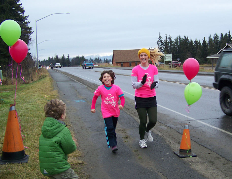 Nicole Vendenaal completes Saturday's 5K Girls on the Run with her running buddy, Britni Johnson. The program for  girls in grades three-five aims at educating and inspiring them for a lifetime of self-respect and healthy living.-Photos by McKibben Jackinsky, Homer News