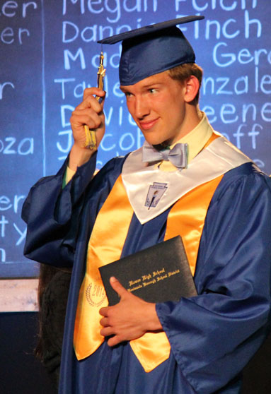 John Walsworth, valedictorian, completes his walk across the stage.-Photo by McKibben Jackinsky, Homer News