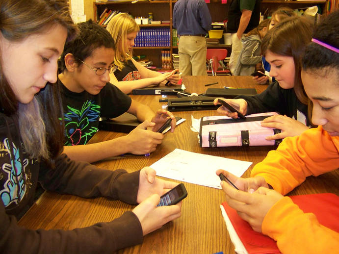 Chapman School seventh- and eight-graders Diana Gaedecke, Billy Johnson, Laila Isaac, Katrina Applehanz (not seen), Heather Harrington and Uno Mireles use iPods to define and find examples of convection, conduction and radiation.-Photos by McKibben Jackinsky, Homer News