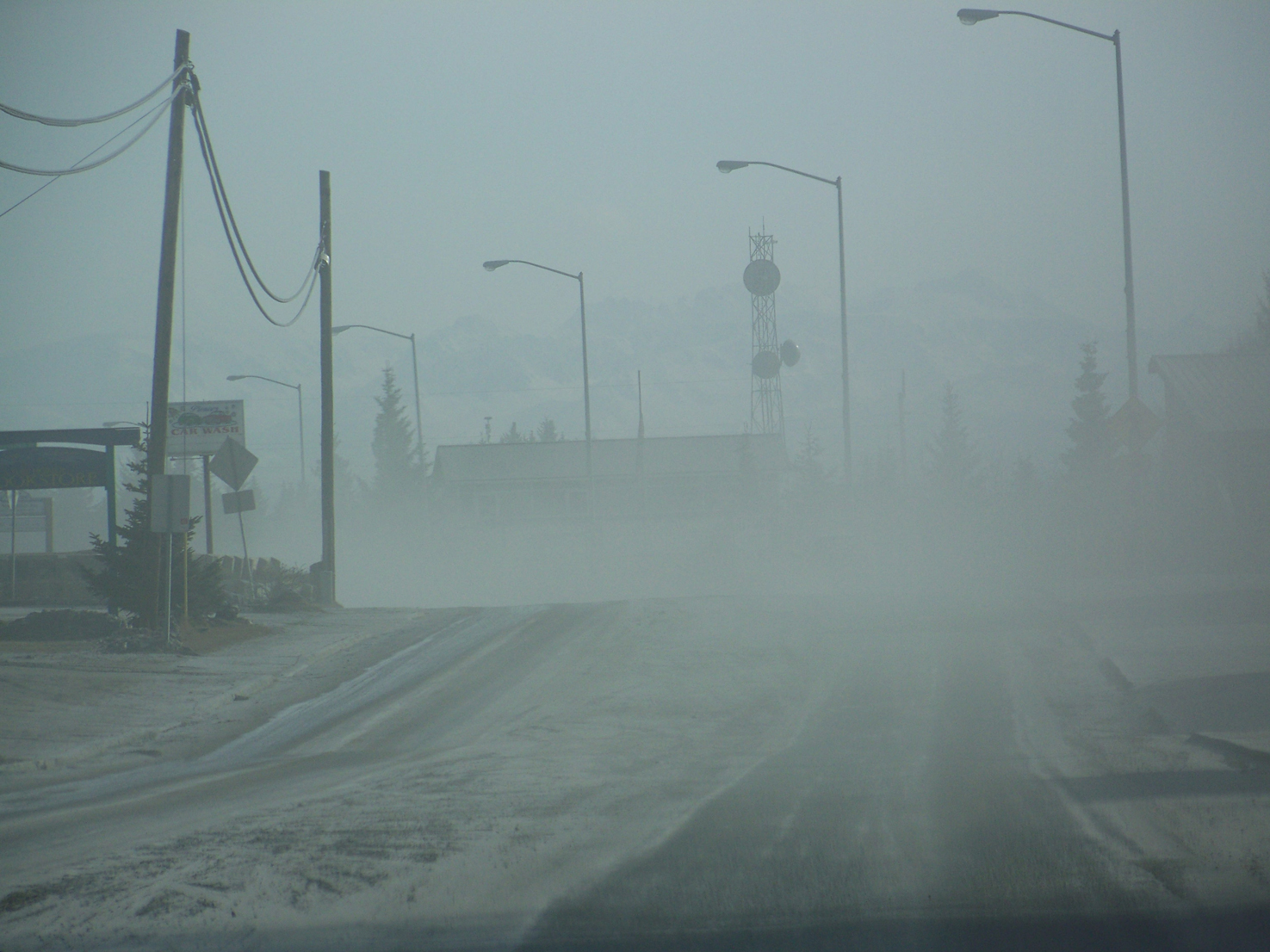 Ashfall during the 2009 eruption of Redoubt Volcano reduces visibility along Homer's Pioneer Avenue.-Photo by McKibben Jackinsky, Homer News