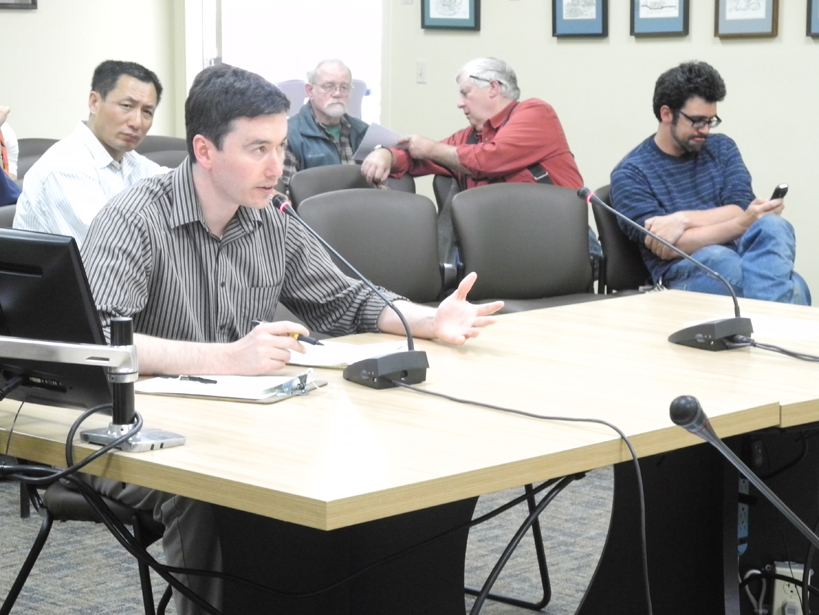 Land's End chief financial officer Josh Garvey testifies on water-sewer rates at the Homer City Council.
