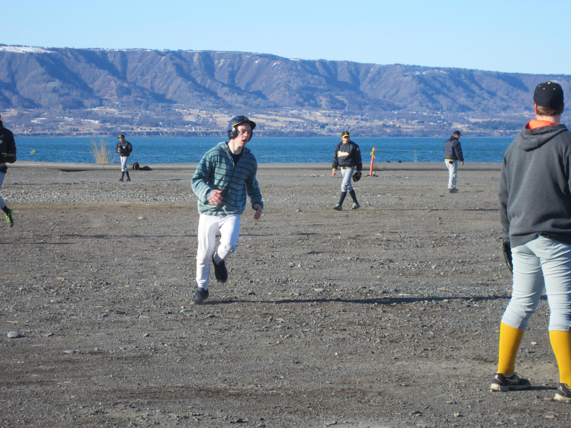 Mariner Wylie Donich rounds third base during a recent practice at the Homer Spit. The baseball field is still covered in snow — a situation facing other schools around the state.-Photo provided