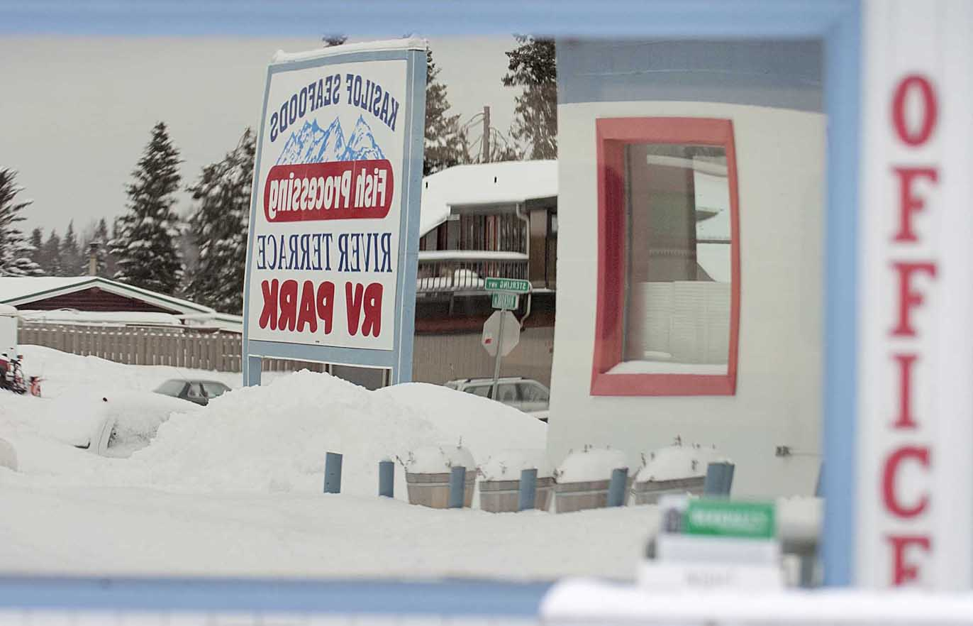 A sign in front of the River Terrace RV Park in Soldotna is reflected in an office window. The RV park is participating in the city's storefront improvement grant program.