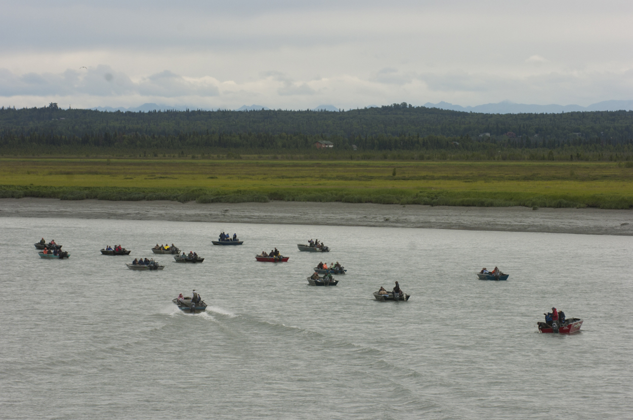 In this July 2006 photo, a crowded group of anglers work the Kenai River for king salmon near the Warren Ames Memorial Bridge in Kenai.-Peninsula Clarion file photo