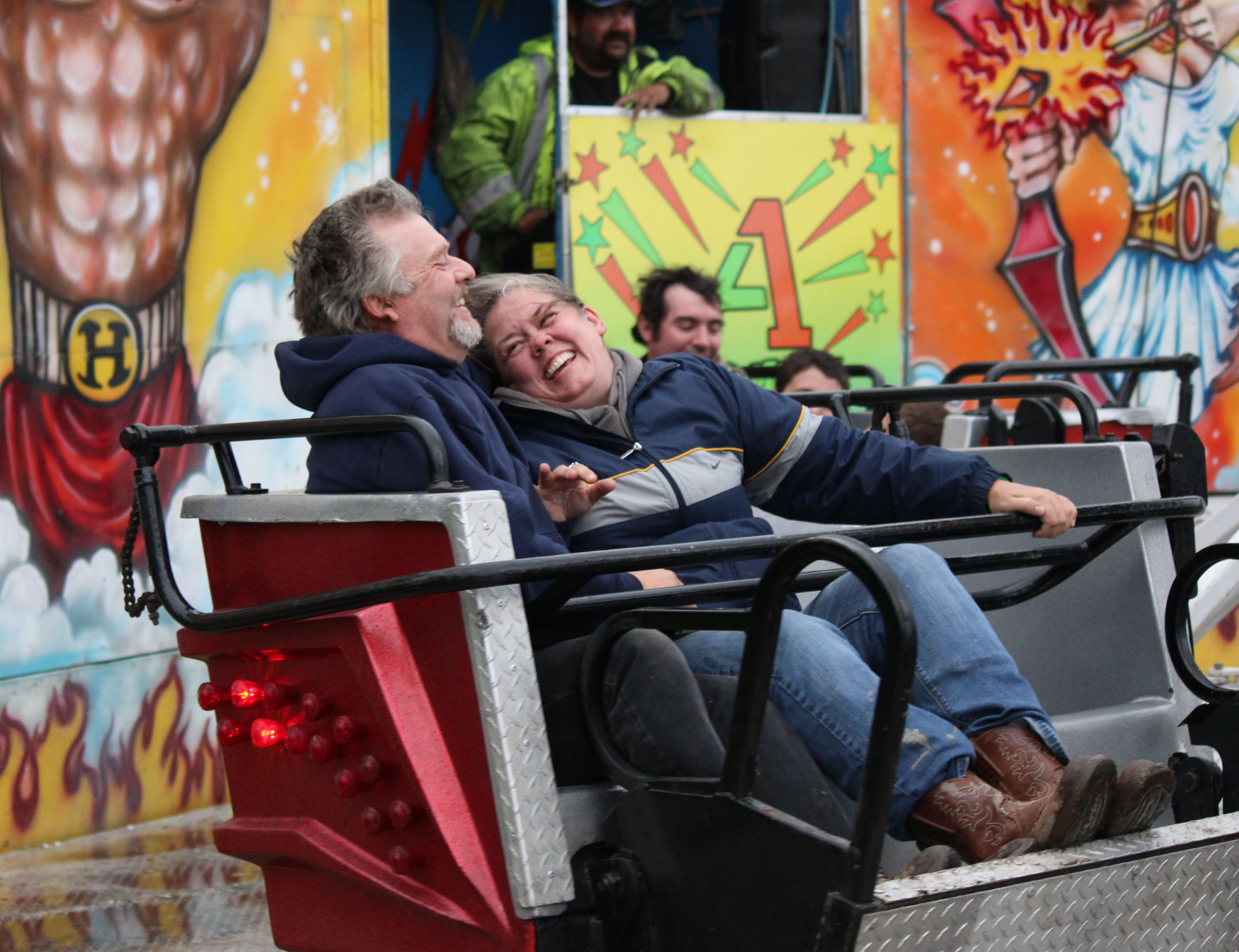 Ray Rodeheauer and Suzanne Lagasse of Soldotna get some laughs riding the Sizzler at the Kenai Peninsula Fair carnival on Saturday night.-Photo by McKibben Jackinsky, Homer News