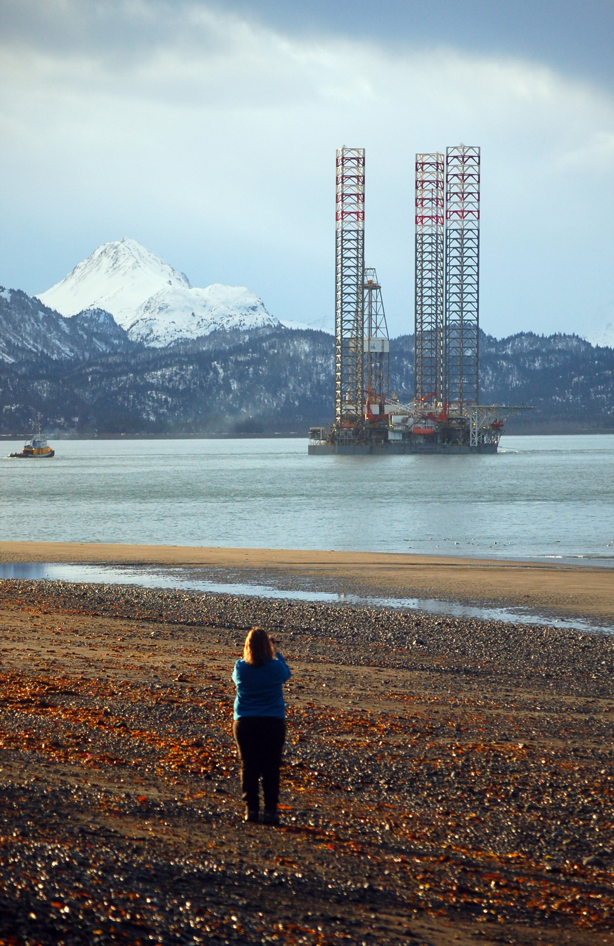 A woman takes a photo of the Endeavour-Spirit of Independence as it left Homer this morning about 8:30 -Photo by Michael Armstrong, Homer News