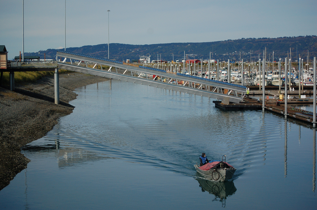 A boat passes under the new Ramp 3 at the Homer Harbor last Friday. -Photo by Michael Armstrong, Homer News
