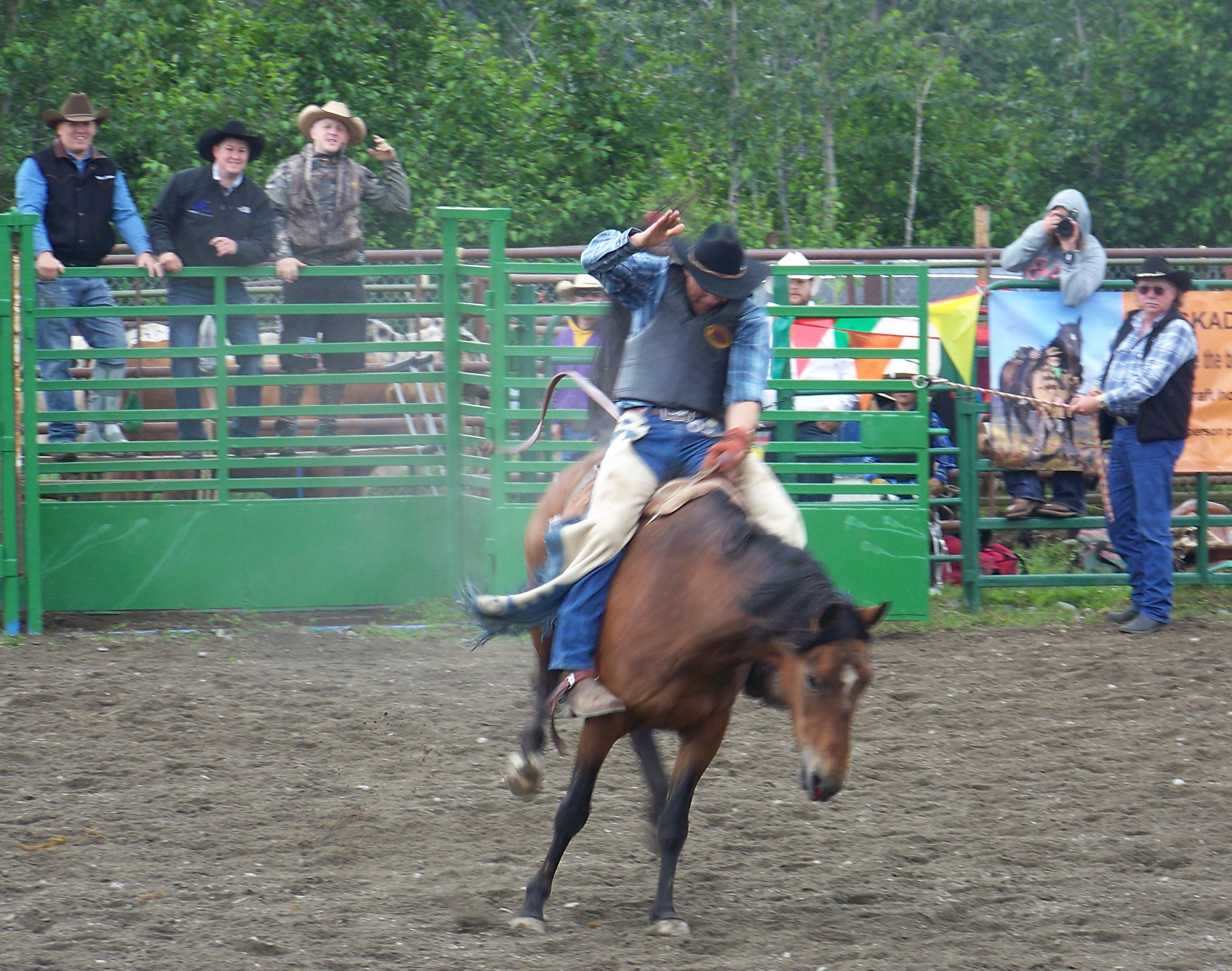 Ninilchik rodeo family camaraderie is evident in each event, whether it's a young cowboy experiencing the thrill of calf riding, a bull rider trying to hang on for eight seconds, or the two-member teams in the roping competitions.-Photo by McKibben Jackinsky, Homer News
