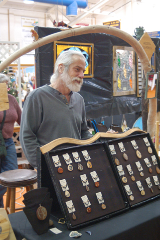 Scott Miller greets customers to his booth at the 2011 Nutcracker Faire. Miller makes inlaid wooden pendants and small plaques.-Photos by Michael Armstrong, Homer News