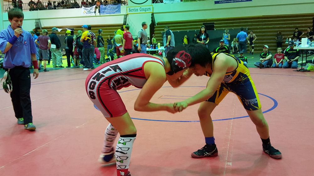 Jadzia Martin wrestles her opponent during a Alaska Battle Cats freestyle tournament match on Saturday, April 16 at Service High. Martin finished first place in the tournament.-Provided by Anchor Kings