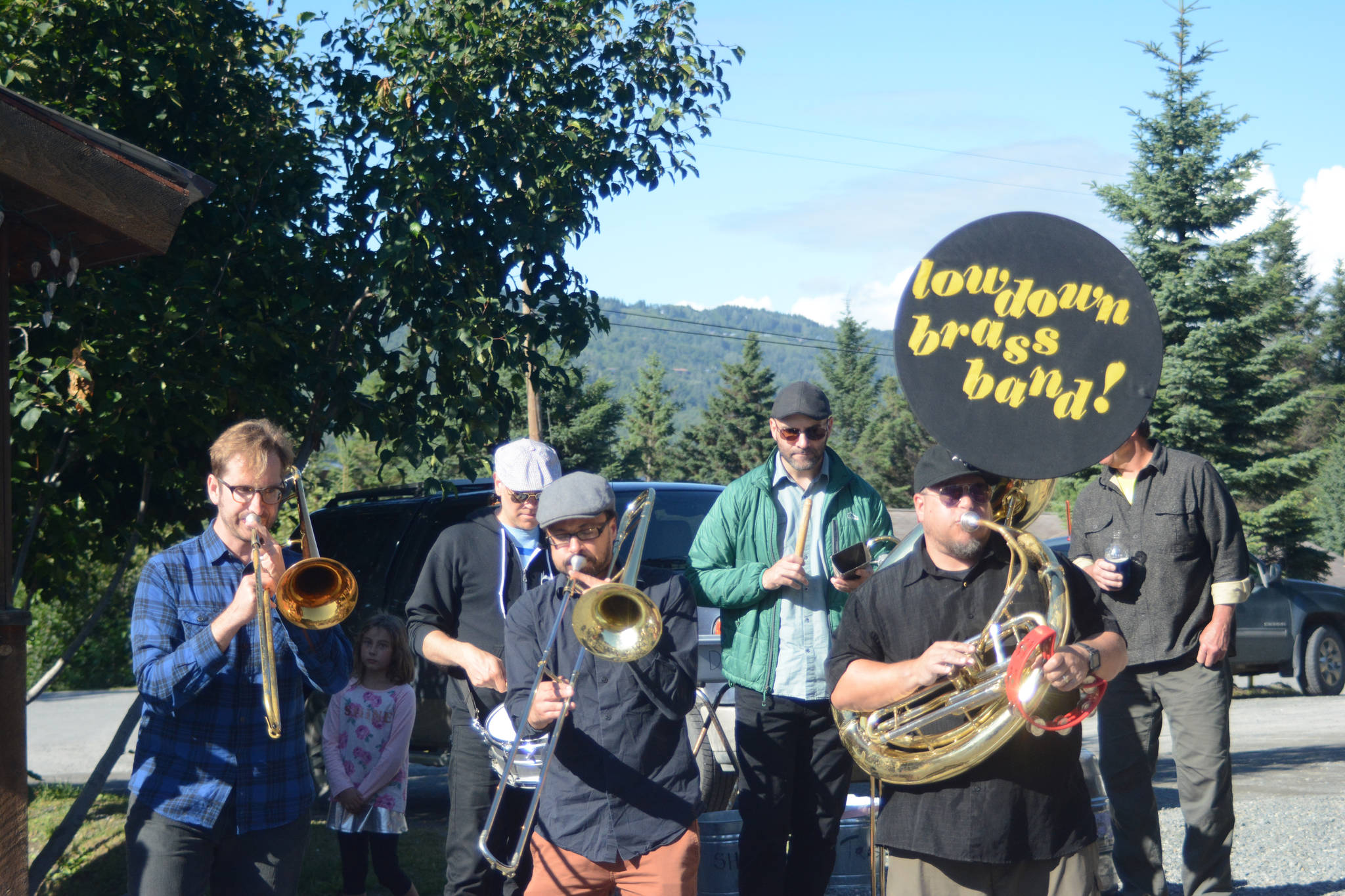 Members of the LowDown Brass Band perform an impromptu session Tuesday Aug. 7, 2018 at the Homer Brewery in Homer, Alaska. The band played at Salmonfest on Saturday, at Alice's Champagne Palace on Tuesday and at Soldotna Creek Park on Wednesday. (Photo by Michael Armstrong/Homer News)