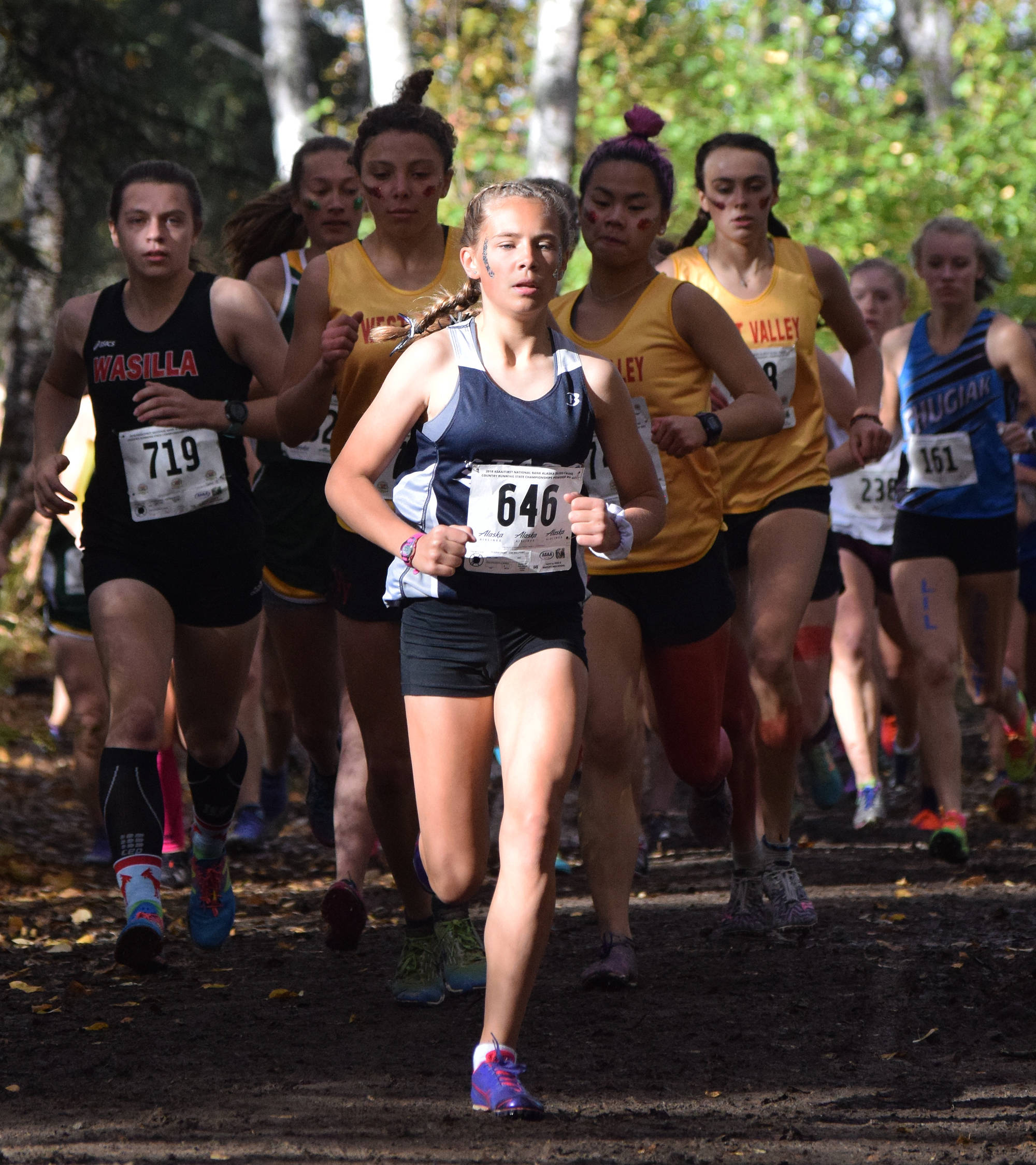 Soldotna freshman Jordan Strausbaugh (646) leads a pack of runners early in Saturday's Division I girls race at the ASAA state cross-country running championships at the Bartlett Trails in Anchorage. (Photo by Joey Klecka/Peninsula Clarion)